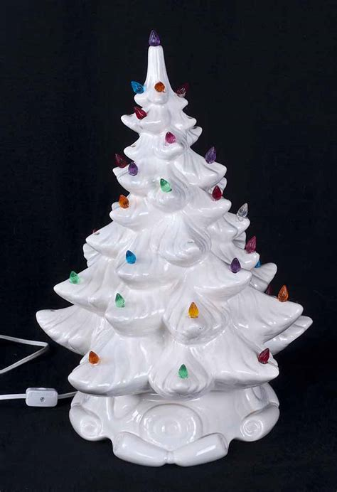 white ceramic christmas tree with colored lights white