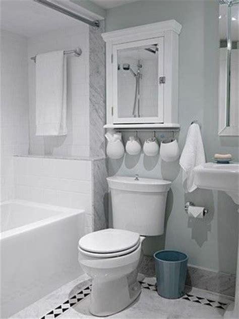 bathroom towel cabinet above toilet towel rack in bathtub hanging hooks from cabinet above