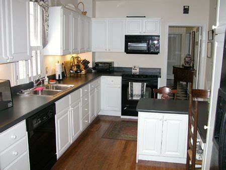 White Kitchen Cabinets Black Appliances Black Cabinets With White Appliances Home Design Inside