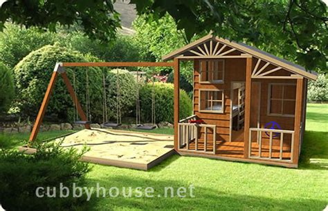 swing set cubby house kids playing on swing sets helps them learn balance and