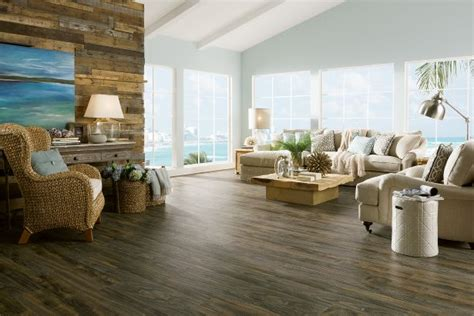 living room beach cottage with wood flooring and sloped ceiling weathered beach wood l3080 laminate
