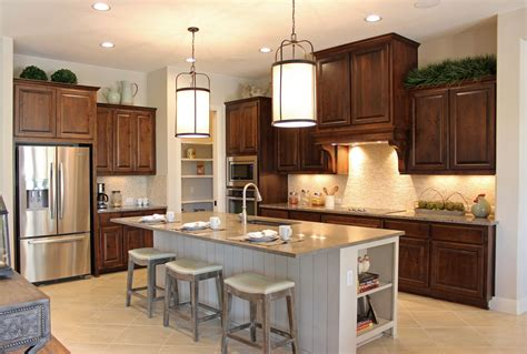 stained oak french kitchen hood design ideas page 1 burrows cabinets kitchen in knotty alder w custom vent hood