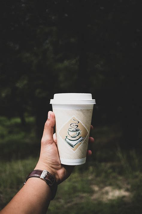 photo  person holding white paper cup  stock photo