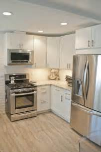 small kitchen with white cabinets ikea adel cabinetry in white cambria countertops in bellingham and a gray tile