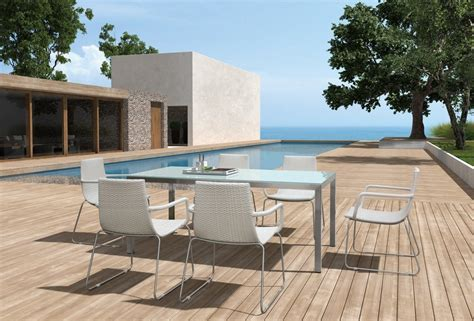 enjoy a relaxed dining on the patio with modern furniture