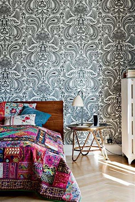 bold bohemian chic bedroom paisley feature wall timber