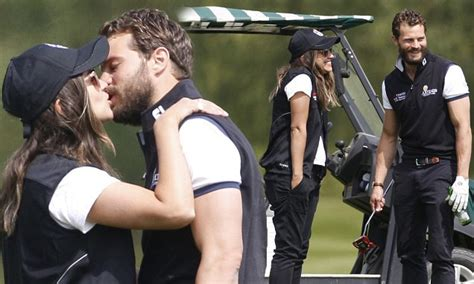 jamie dornan ryder cup jamie dornan kisses wife amelia warner on a golf course