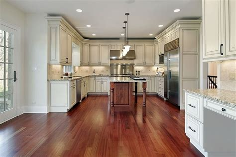 dark island w cream colored cabinets silver hardware 31 quot new quot custom white kitchens with wood islands