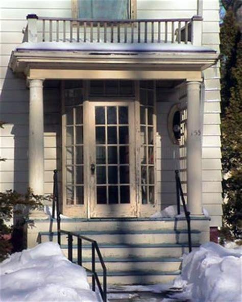 enclosed entry front porch enclosed vestibule at an entrance door on a columned porch
