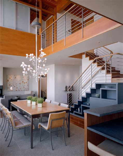 staircase design with dinning table dining room with staircase dining room contemporary with solid doors fir ceiling open kitchen
