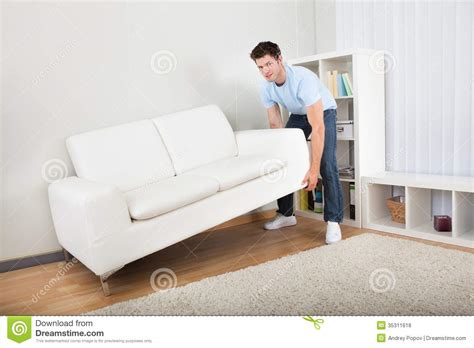 man couch man lifting couch royalty free stock photos image 35311618