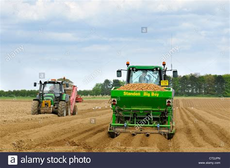uk farming commercial potato growing tractor with potato