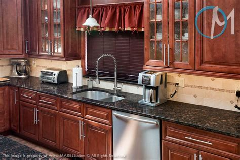 cinnamon cherry color grey granite countertops with cinnamon cherry cabinets