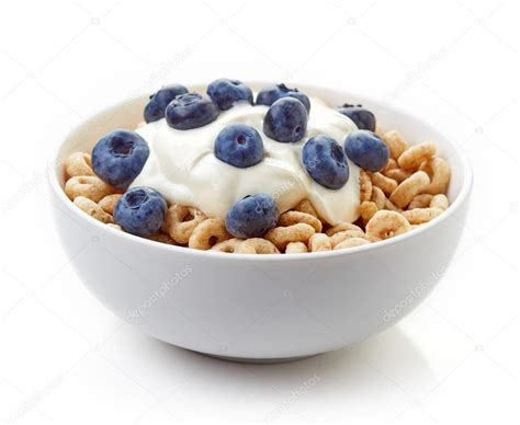 whole grains in cheerios bowl of whole grain cheerios cereal with blueberries and