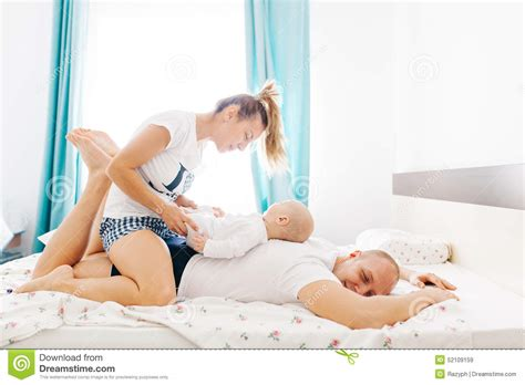 fun in bed family morning in bed stock photo image 52109159