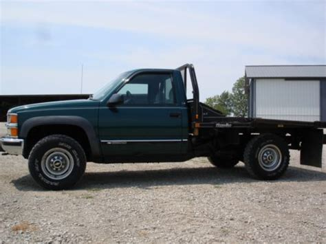find used 4x4 with hydra bed bale bed and tool box in