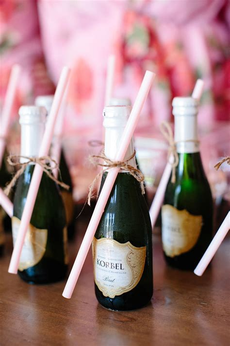 Cute mini champagne bottles with straws for getting ready