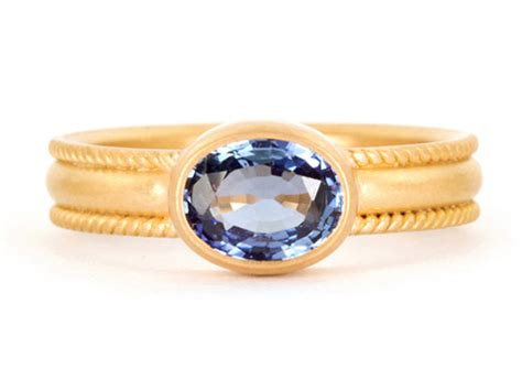 sapphire engagement ring with thick yellow gold band