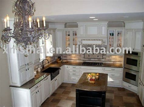white kitchen cabinets with granite countertops benefits tropical brown granite white cabinets dark tile floor