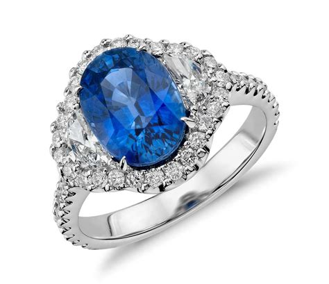 blue sapphire and halo three ring in 18k