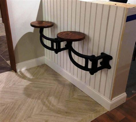 swing arm bar stools cast iron and wood suspended swing out arm kitchen or bar
