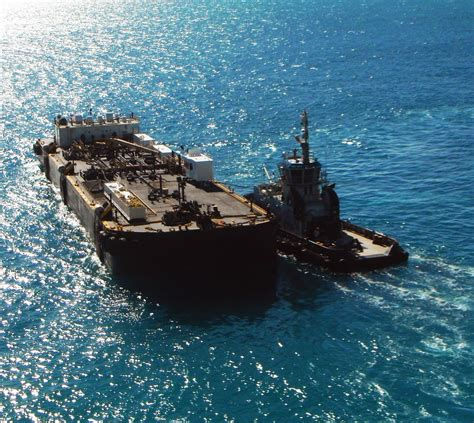 tug boat depot tug boat escorting fuel barge to fuel depot love s photo