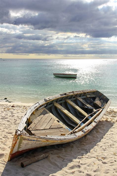 old boat on beach mauritius old battered boat on the beach 9 romeodesign