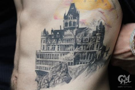 cliff tattoo burning cliff house by capone tattoonow