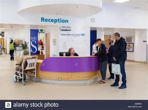 hospital reception patients at the reception desk