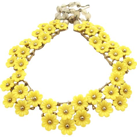 vintage molded plastic yellow flower choker necklace from