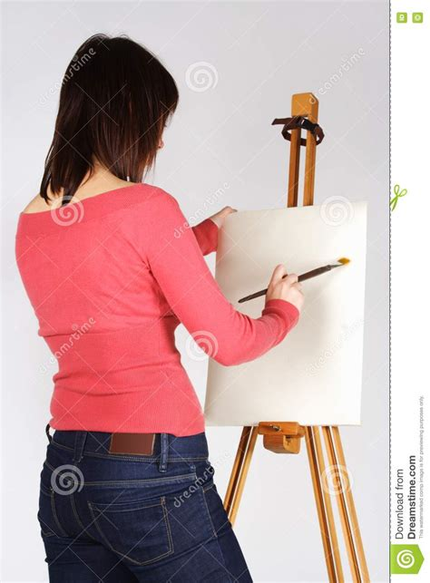 girl standing  easel  painting stock photo image