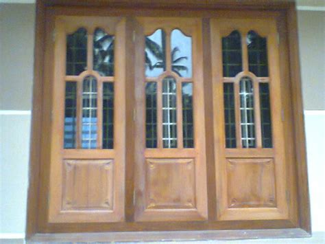 home windows design in wood kerala style carpenter works and designs december 2013