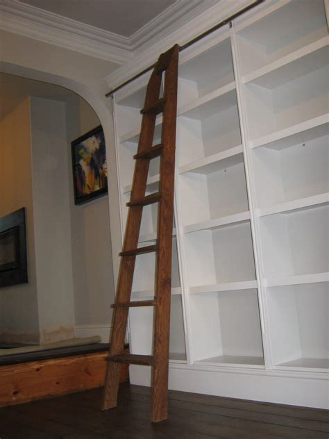 oak library ladder and traditional painted bookcase