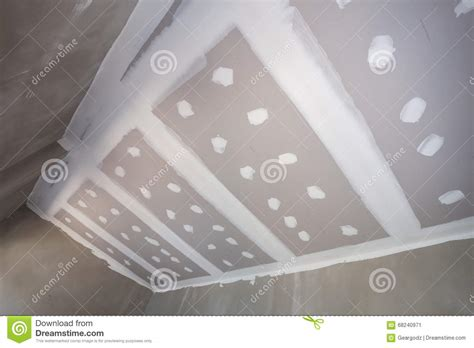 gypsum board ceiling at construction site stock photo