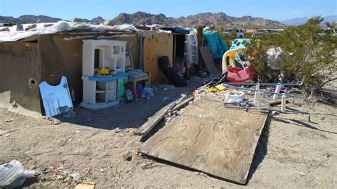 couple arrested after 7 kids found living in filthy joshua tree couple arrested after three kids found living