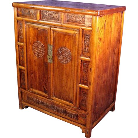 teak armoire early chinese carved teak cabinet armoire chest wardrobe asian from treasureislandinteriors on