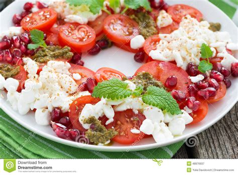fresh salad with tomatoes cottage cheese pesto and