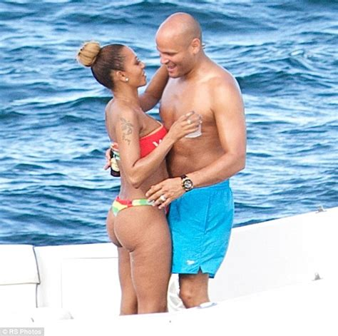 girl on front of boat mel b and stephen belafonte toast the good life on love