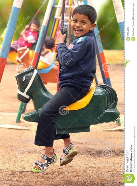 Set Shown Kid happy handsome boy kid on swing sets in a