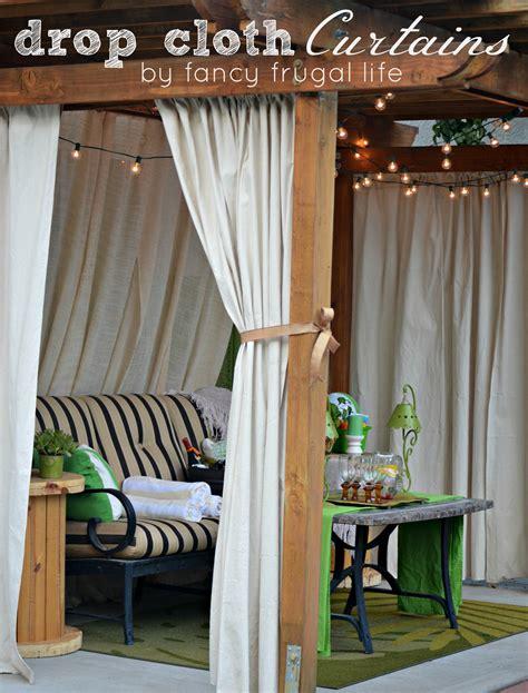 cabana patio makeover  diy drop cloth curtains