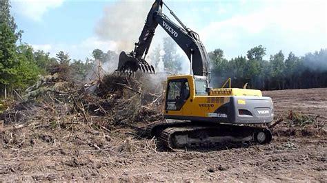 volvo  excavator stacking burn pile youtube