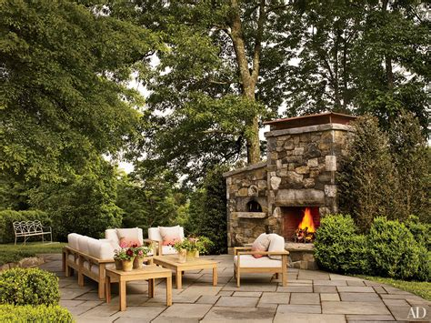 add interest to your backyard with a fireplace
