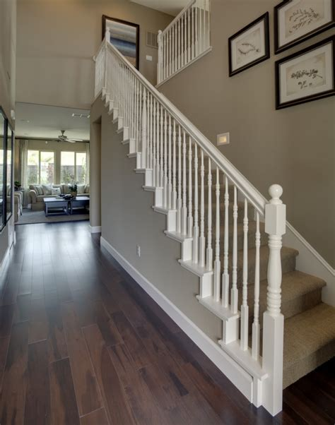 staircases and banisters love the white banister wood floors and the wall color