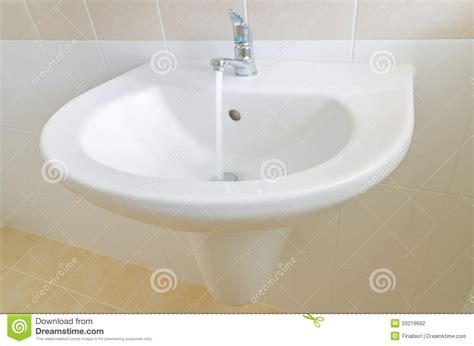 Clean Sink Faucet by White Sink And Faucet In A Bathroom Stock Photography Image 33219692