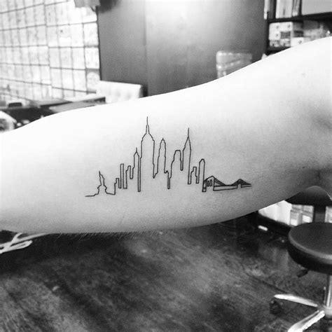 infinity tattoo manhattan new york skyline tattoo on the right inner arm tattoo