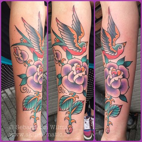 rose and swallow tattoo beautiful traditional and done by sebastiaan