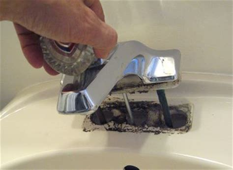how to remove faucet from kitchen sink installing a new bathroom faucet