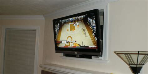 fireplace tv installation nook or cut out