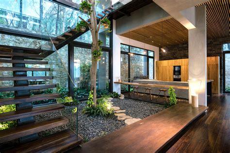 indoor courtyard garden surrounded   staircase