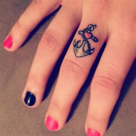 middle finger tattoo designs small anchor on middle finger